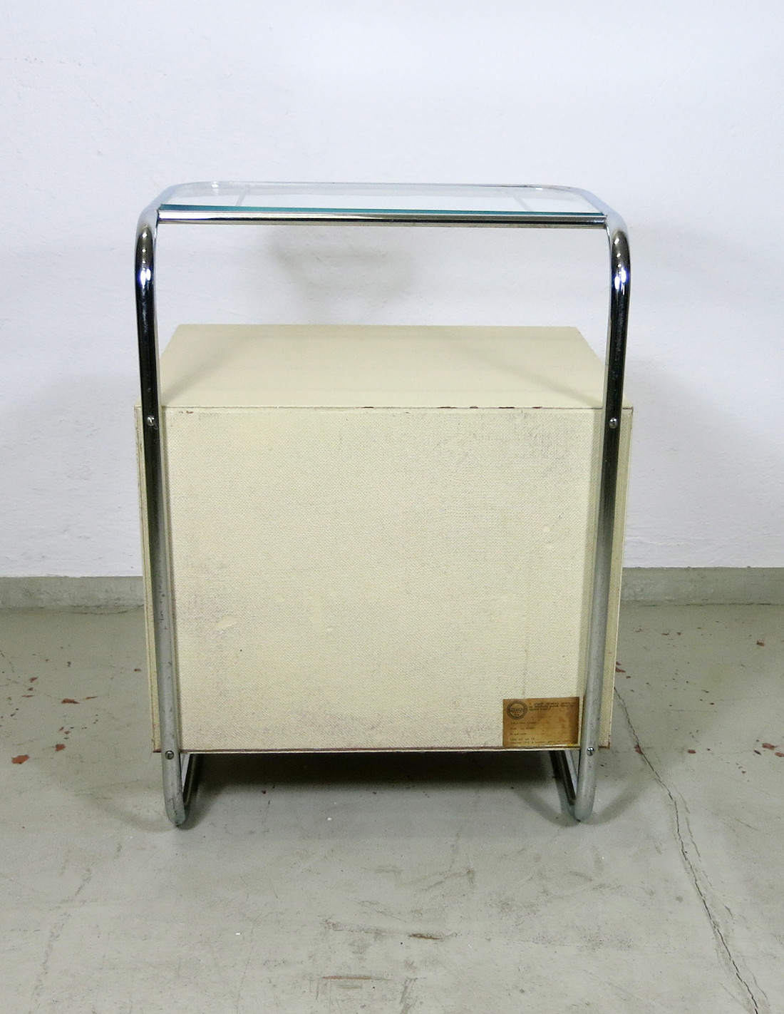 Bedside table with tubular steel frame and glass top by Kovona